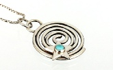 Universal Spiral Pendant Handmade in Sterling Silver with Turquoise Bezel Set Cabochon In the Centre of A Shining Star